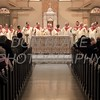 Priests gather on the alter of Cathedral of Saint Peter to bless the host during Opening Mass of the 150th Anniversary of the Dioceses of Wilmington. wwwDonBlakePhotography.com