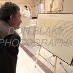 Jeff Munsch of Holy Family Parish checks out a copy of the Apostolic Brief erecting the Diocese of Wilmington the Cathedral of Saint Peter after the Opening Mass of the 150th Anniversary of the Dioceses of Wilmington. wwwDonBlakePhotography.com