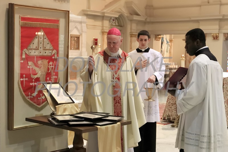 Bishop Malooly blesses the plaques with the names of the designated Pilgrimage Churches during Opening Mass of the 150th Anniversary of the Dioceses of Wilmington. wwwDonBlakePhotography.com
