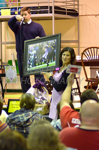 Auctioneer Scott Slavin takes a bid as Laura Morris displays a auction item during Good Shepherd's No-So-Silent Auction to benefit Good Shepherd School in Perryville, Maryland, March 24, 2012. photo/ www.DonBlakePhotography.com