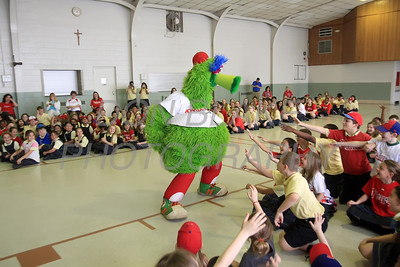 The Phillie Phanatic gets the students cheering at Our Lady of Fatima School, Friday, March 23, 2012. photo/ www.DonBlakePhotography.com