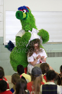 The Phillie Phanatic jokes around with one of the teachers at Our Lady of Fatima School, Friday, March 23, 2012. photo/ www.DonBlakePhotography.com