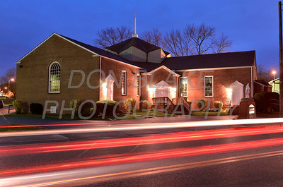 Streaks of lights from passing cars illuminate the night in front of Good Shepherd Church in Perryville, Maryland, March 24, 2012. photo/ www.DonBlakePhotography.com
