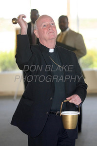 Bishop Malooly blesses the new space for St. Francis Healthcare Life program at the Shipyard Center on the Riverfront, Monday, March 26, 2012 photo/ www.DonBlakePhotography.com