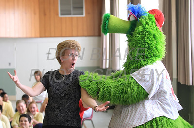 Principal Kathleen Kenney dances with the Phillie Phanatic at Our Lady of Fatima School, Friday, March 23, 2012. photo/ www.DonBlakePhotography.com