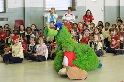 The Phillie Phanatic lays on the ground to get comfortable as the Kate Julian reads his book about him at Our Lady of Fatima School, Friday, March 23, 2012. photo/ www.DonBlakePhotography.com