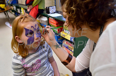 Sophia Lueller has her face painted by Ashley Livningston during Good Shepherd's No-So-Silent Auction to benefit Good Shepherd School in Perryville, Maryland, March 24, 2012. photo/ www.DonBlakePhotography.com