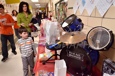Shanin Ormord and her son Ethan bid on items in the Chinese Auction during Good Shepherd's No-So-Silent Auction to benefit Good Shepherd School in Perryville, Maryland, March 24, 2012. photo/ www.DonBlakePhotography.com