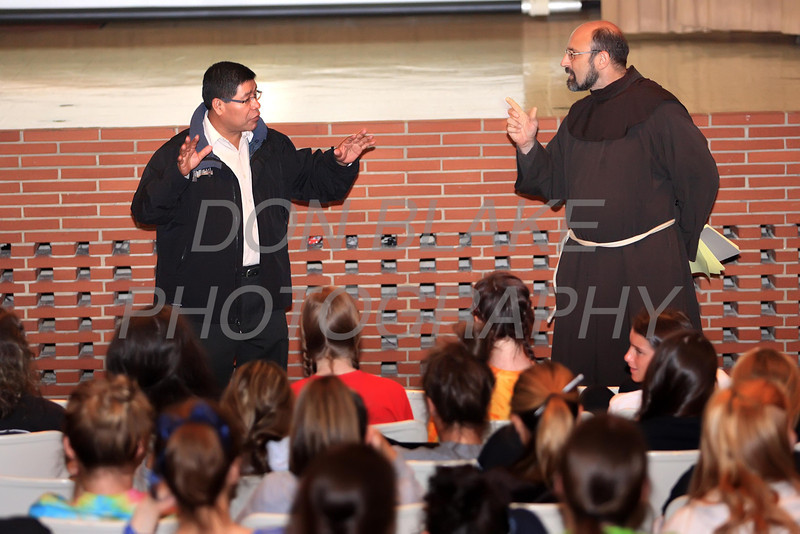 Fr. Silverio Chun, visiting from San Marcos, Guatemala talks to students at Padua Academy with the help from Fr. Chris Posch, Thursday, April 26, 2012. photo/ www.DonBlakePhotography.com
