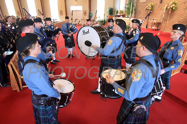 The Delaware State Police Pipes & Drums play before mass as members of the military, state, county, and local law enforcement along with emergency personal gathered for the annual Blue Mass at St. John the Beloved Church, Friday, May 4, 2012. photo/ www.DonBlakePhotography.com