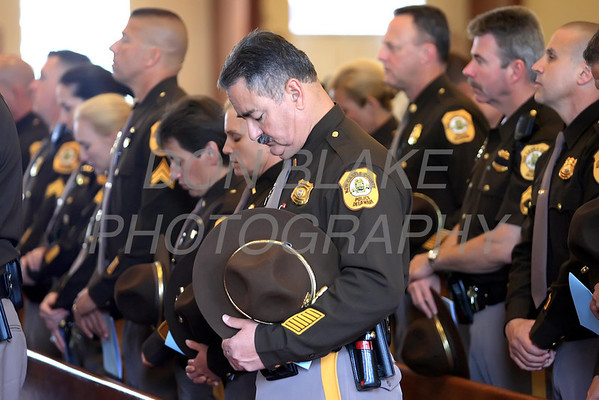 Police officers from the New Castle County Police Department pray during mass as members of the military, state, county, and local law enforcement along with emergency personal gathered for the annual Blue Mass at St. John the Beloved Church, Friday, May 4, 2012. photo/ www.DonBlakePhotography.com