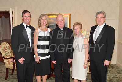 Awardee Mark Reardon (left) his wife Megan Reardon, Bishop Malooly, Cabby Flynn wife of awardee Tony Flynn during to  St. Thomas More Society Award banquet at Wilmington Country Club.