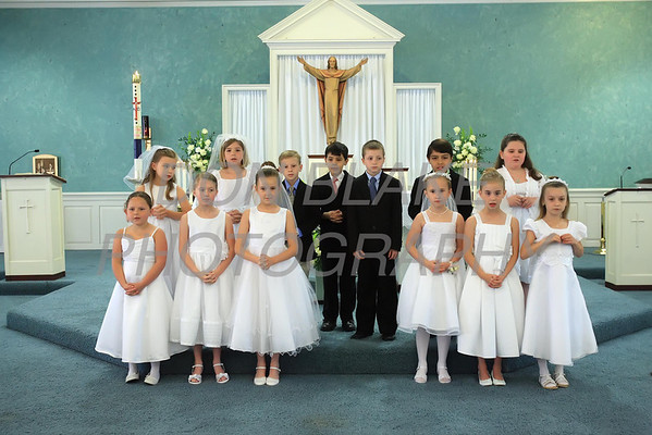 The children stand on the alter at the beginning on their First Communion Mass at Sacred Heart Church, Chestertown, Maryland, Sunday. May 6, 2012. photo/ www.DonBlakePhotography.com