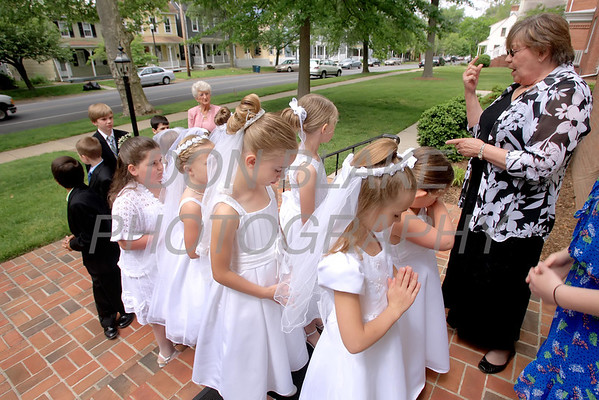 Director of Religious Education Barbara Kelly gives last minute instructions to the children before First Communion Mass at Sacred Heart Church, Chestertown, Maryland, Sunday. May 6, 2012. photo/ www.DonBlakePhotography.com