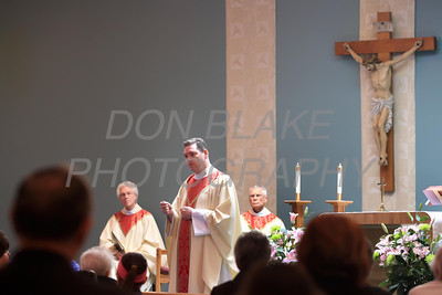 Fr. Timothy Nolan speaks with Fr. Joseph Drobinski and Fr. John Hynes on the alter duirng the Anointing of the Sick mass at Corpus Christi Church, Elsmere, Del., May 10, 2012.. photo/DonBlakePhotography.com