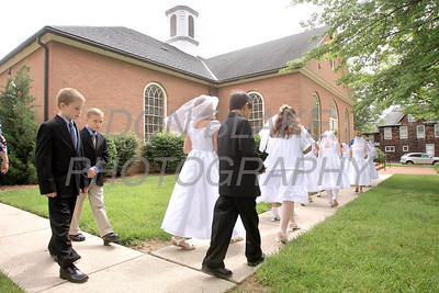The children processes to the front of the church before First Communion Mass at Sacred Heart Church, Chestertown, Maryland, Sunday. May 6, 2012. photo/ www.DonBlakePhotography.com
