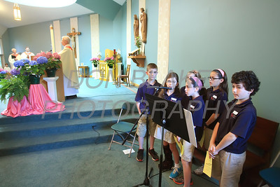 5th grade students from All Saints School during the The Sacrament of the Anointing of the Sick mass at Corpus Christi Church, Elsmere, Del., May 10, 2012.. photo/DonBlakePhotography.com