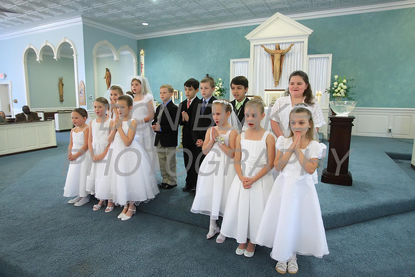 The children sing a song on the alter at the beginning on their First Communion Mass at Sacred Heart Church, Chestertown, Maryland, Sunday. May 6, 2012. photo/ www.DonBlakePhotography.com