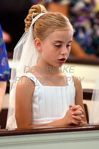 DeLayne Hemingway prays duing First Communion Mass at Sacred Heart Church, Chestertown, Maryland, Sunday. May 6, 2012. photo/ www.DonBlakePhotography.com