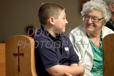 Stephen Bolen 5th grade talks with Helen Burton of Corpus Christi Parish before The Sacrament of the Anointing of the Sick mass at Corpus Christi Church, Elsmere, Del., May 10, 2012. 5th grade students from All Saints School are matched up with the senior citizens they have been corresponding with this year. photo/DonBlakePhotography.com