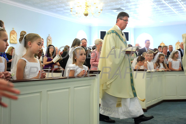 Fr. Paul Campbell processes to the alter during First Communion Mass at Sacred Heart Church, Chestertown, Maryland, Sunday. May 6, 2012. photo/ www.DonBlakePhotography.com