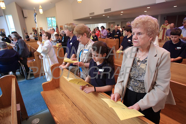 5th grade students from All Saints School are matched up with the senior citizens they have been corresponding with this year for the The Sacrament of the Anointing of the Sick mass at Corpus Christi Church, Elsmere, Del., May 10, 2012.. photo/DonBlakePhotography.com
