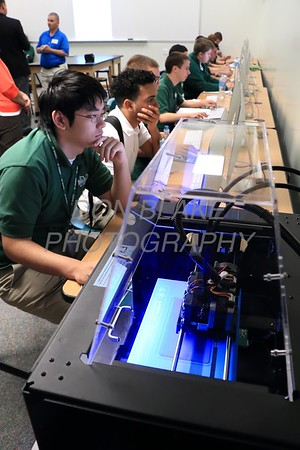 Students work on the computers as the 3D printer prints. wwwDonBlakePhotography.com