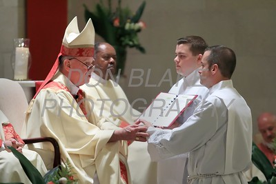 Bishop Maooly prays with Richard Jasper during his Ordination to the Diaconate at St. Elizabeth Church, Sunday, May 22, 2016. wwwDonBlakePhotography.com