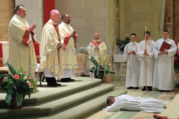 Richard Jasper prostrates him self during his Ordination to the Diaconate at St. Elizabeth Church, Sunday, May 22, 2016. wwwDonBlakePhotography.com