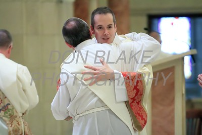 Richard Jasper gives the Kiss of Peace to the other Deacons during his Ordination to the Diaconate at St. Elizabeth Church, Sunday, May 22, 2016. wwwDonBlakePhotography.com