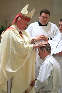 Bishop Maooly lays hands on Richard Jasper during his Ordination to the Diaconate at St. Elizabeth Church, Sunday, May 22, 2016. wwwDonBlakePhotography.com