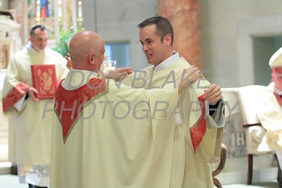 Fr. Norman Carroll vests Richard Jasper during his Ordination to the Diaconate at St. Elizabeth Church, Sunday, May 22, 2016. wwwDonBlakePhotography.com