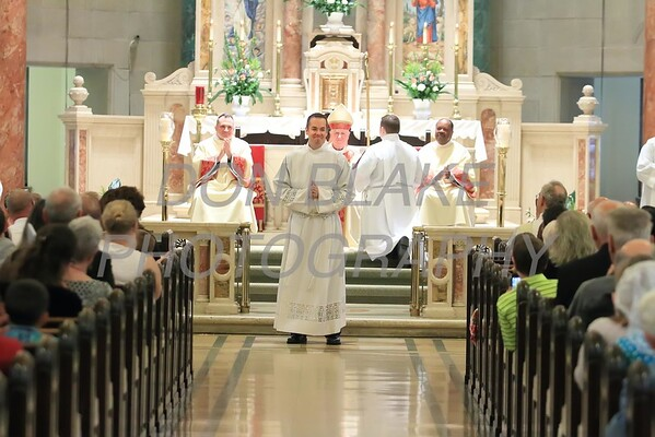 Richard Jasper stands before the crowd as they clap during his Ordination to the Diaconate at St. Elizabeth Church, Sunday, May 22, 2016. wwwDonBlakePhotography.com