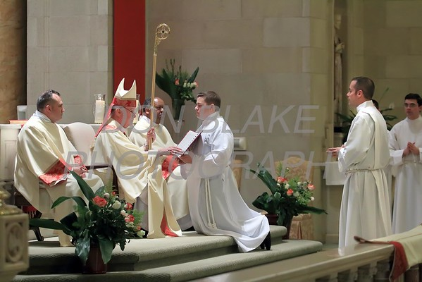 Richard Jasper stands before Bishop Maooly during the promise of elect at his Ordination to the Diaconate at St. Elizabeth Church, Sunday, May 22, 2016. wwwDonBlakePhotography.com