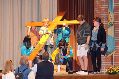 Kids from St. Jude Parish prepare to carry the cross to mass during CHAOS at Padua Academy, Sunday, October 27, 2013. wwwDonBlakePhotography.com