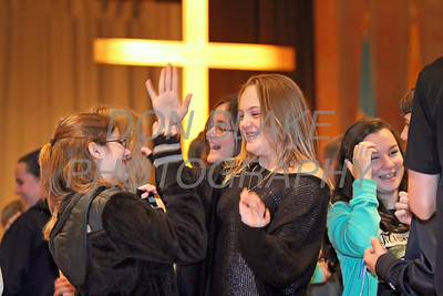 Francesca Knoll age 13 (left) and Rita Offutt age 13 both from St. Mary Magdalen Parish high five after get an answer right during the ice breaker at CHAOS, Sunday, October 27, 2013. wwwDonBlakePhotography.com