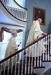 Bishop Malooly along with Pastor John Gayton head to the second floor as they blesses the inside of the Holy Rosary Pastoral Center Dedication, Sunday, October 30. 2011. photo/Don Blake Photography