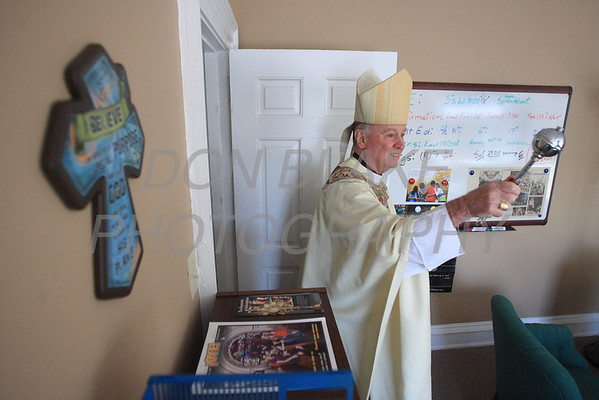 Bishop Malooly blesses the inside of the Holy Rosary Pastoral Center Dedication, Sunday, October 30. 2011. photo/Don Blake Photography