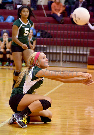Cara Eppes, setter for the Archmere Academy volleyball team makes a dig during the Concord game, Monday, October 31, 2011. photo/Don Blake Photography