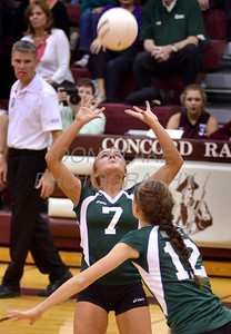 Cara Eppes, setter for the Archmere Academy volleyball team sets the ball for teammate Megan Carney during the Concord game, Monday, October 31, 2011. photo/Don Blake Photography