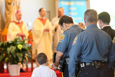 Members of the military, state, county, and local law enforcement along with emergency personal process in for the annual Blue Mass at St. John the Beloved Church, Friday, May 3, 2013. photo/ www.DonBlakePhotography.com