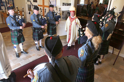 The Delaware State Police Pipes & Drums play as Bishop Malooly prosses out during the annual Blue Mass at St. John the Beloved Church, Friday, May 3, 2013. photo/ www.DonBlakePhotography.com