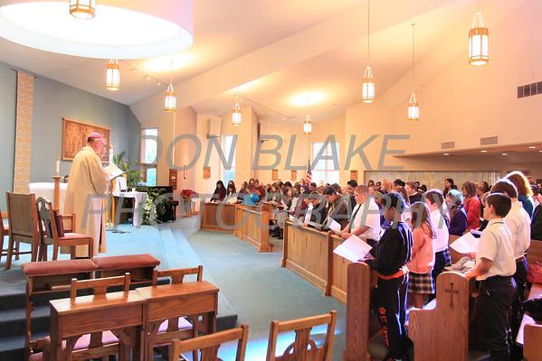 Bishop Malooly leads a prayer service during Vocation Day at Corpus Christi Church, Monday, November 3, 2014. wwwDonBlakePhotography.com