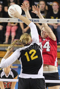 Padua's #12 Erica Engler hits the ball over as Ursuline's #14 Brenna Williams blocks during the Girls State Volleyball Championship at the Bob Carpenter Center, Monday, November 11, 2012. photo/www.DonBlakePhotography.com