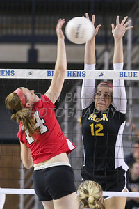 Padua's #12 Erica Engler blocks as Ursuline's #14 Brenna Williams hits the ball over during the Girls State Volleyball Championship at the Bob Carpenter Center, Monday, November 11, 2012. photo/www.DonBlakePhotography.com