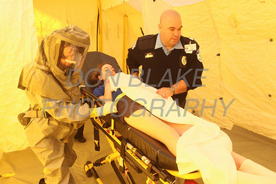 Padua student Natalie Roddy 12th grade is tansported by emergency workers from the decontamination tent into the hospital at St. Francis Hospital during a Mock Disaster at Padua Academy. photo/www.DonBlakePhotography.com