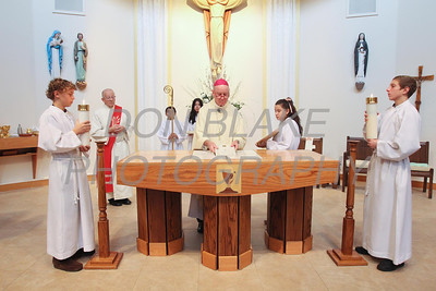Bishop Malooly places the alter stone over the martyrs relics on the alter during the rededication mass at St. Catherine of Siena Church, November 18, 2012. photo/www.DonBlakePhotography.com