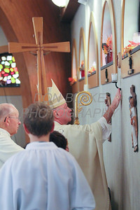 Bishop Malooly anoints the walls of the church during the rededication mass at St. Catherine of Siena Church, November 18, 2012. photo/www.DonBlakePhotography.com