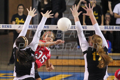 Padua's #14 Sarah Landry and #17 Ashley Muschiatti block as Ursuline's #35 Mary Abram hits the ball over during the Girls State Volleyball Championship at the Bob Carpenter Center, Monday, November 11, 2012. photo/www.DonBlakePhotography.com