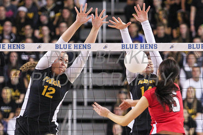 Padua's #12 Erica Engler and #14 Sarah Landry block as Ursuline's #5 Caroline Francois hits the ball during the Girls State Volleyball Championship at the Bob Carpenter Center, Monday, November 11, 2012. photo/www.DonBlakePhotography.com